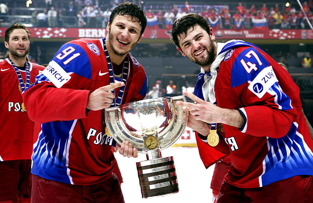 Russia's Saprykin and Radulov hold the trophy after beating Canada in the IIHF World Hockey Championship gold medal game in Bern