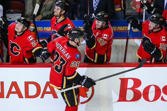 Oct 6, 2013; Calgary, Alberta, CAN; Calgary Flames center Sean Monahan (23) celebrates his goal with teammates during the third period against the Vancouver Canucks at Scotiabank Saddledome. Vancouver Canucks won 5-4. Mandatory Credit: Sergei Belski-USA T