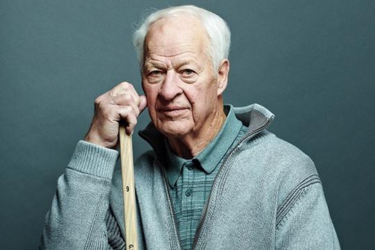 Gordie Howe (Mr. Hockey) holding Northland Pro hockey Stick.