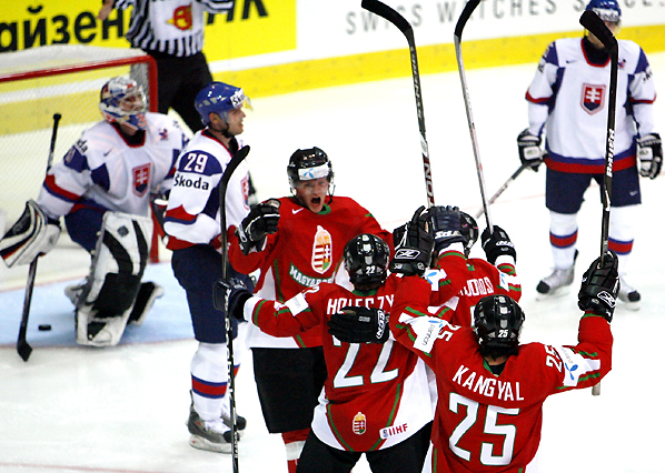 Hungary's Holeczy celebrates his goal against Slovakia with teammates during their IIHF World Hockey Championship game in Zurich
