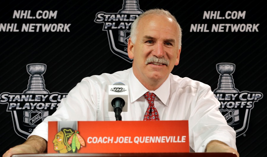 Chicago Blackhawks head coach Joel Quenneville smiles during a news conference after the Blackhawks' 4-3 win over Los Angeles Kings in the second overtime period in Game 5 of the NHL hockey Stanley Cup playoffs Western Conference finals, Saturday, June 8, 2013, in Chicago. The Blackhawks advance to the Stanley Cup finals. (AP Photo/Nam Y. Huh)